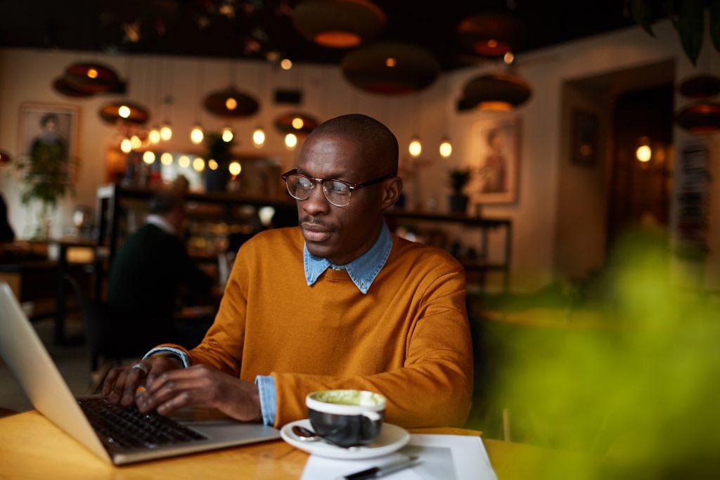 Man enjoying coffee in a coffee shop in Canton, GA.