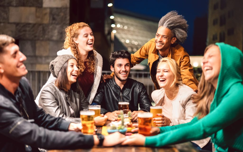 Group of friends enjoying drinks at a local brewery in Brevard, North Carolina.