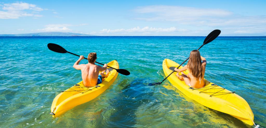 Couple kayaking in the ocean at Cedar Key, Florida.