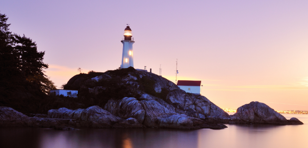Lighthouse overlooking the ocean Oak Island, North Carolina.
