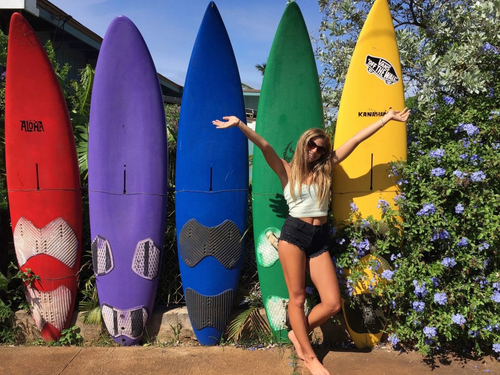 Woman posing with surfboards at a museum in Satellite Beach, Florida.